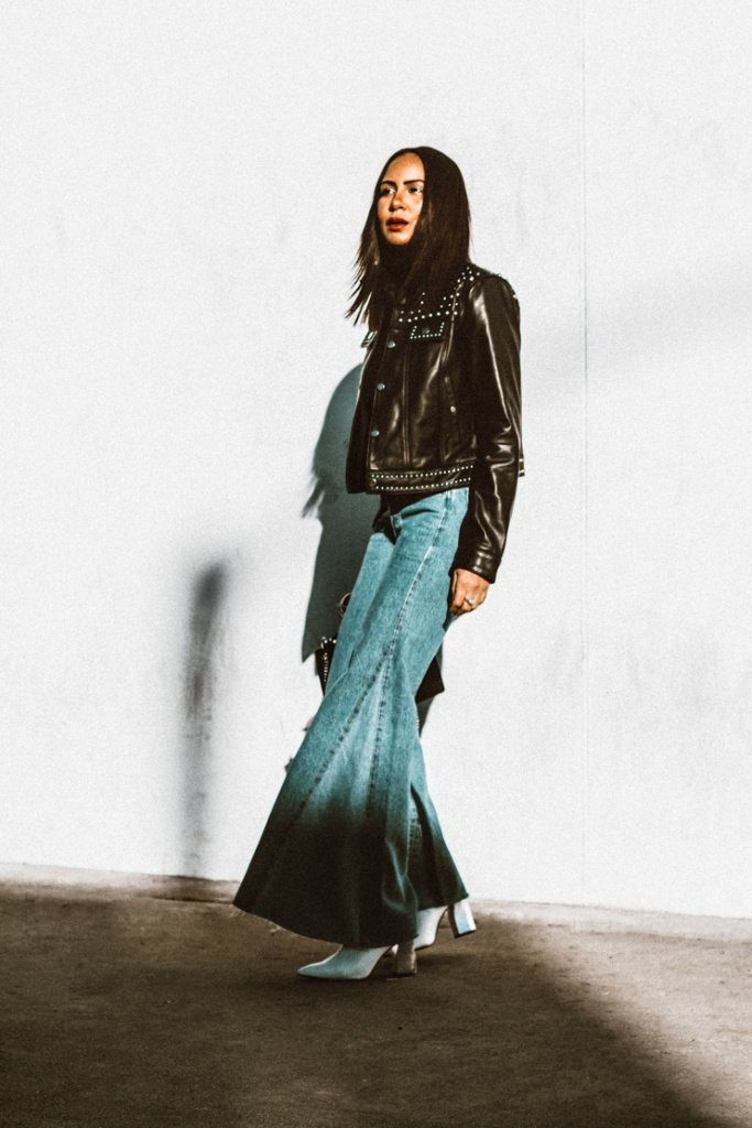 Rebecca Minkoff leather jacket, Levis bell bottoms, cashmere turtleneck, Straight hair, who what wear shoe, Rebeccs Minkoff star bag, black fashion bloggers, Bloggers of color, WOC, woman if color in fashion, taye hansberry blog,