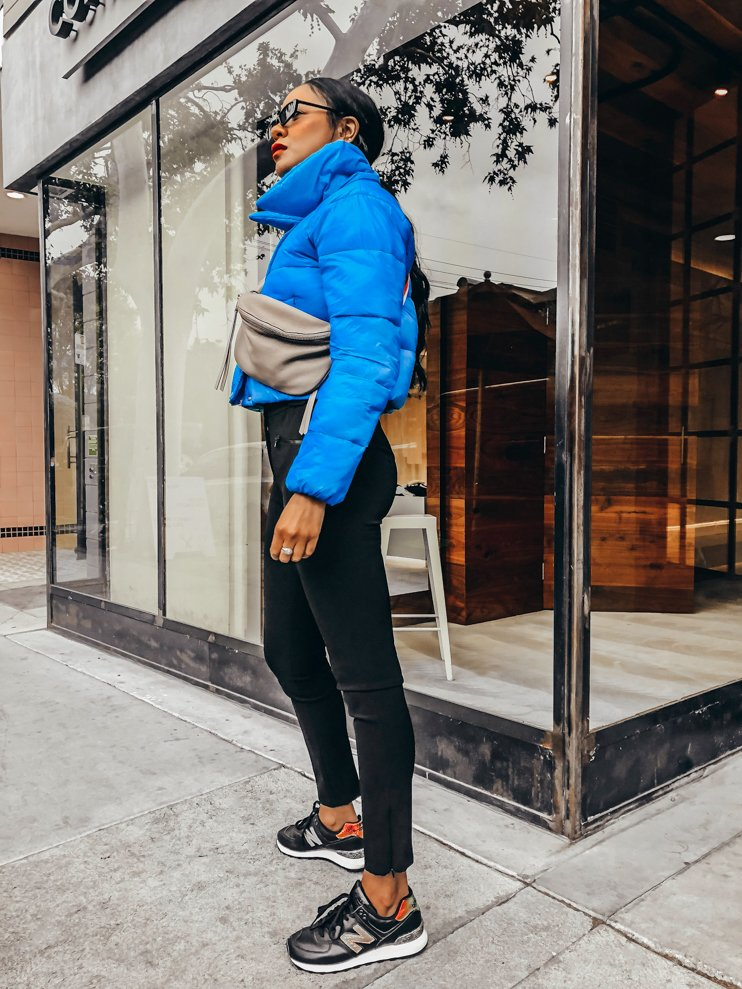 puffer jackets, new balance sneakers, little sunglasses, rebecca minkoff fanny pack