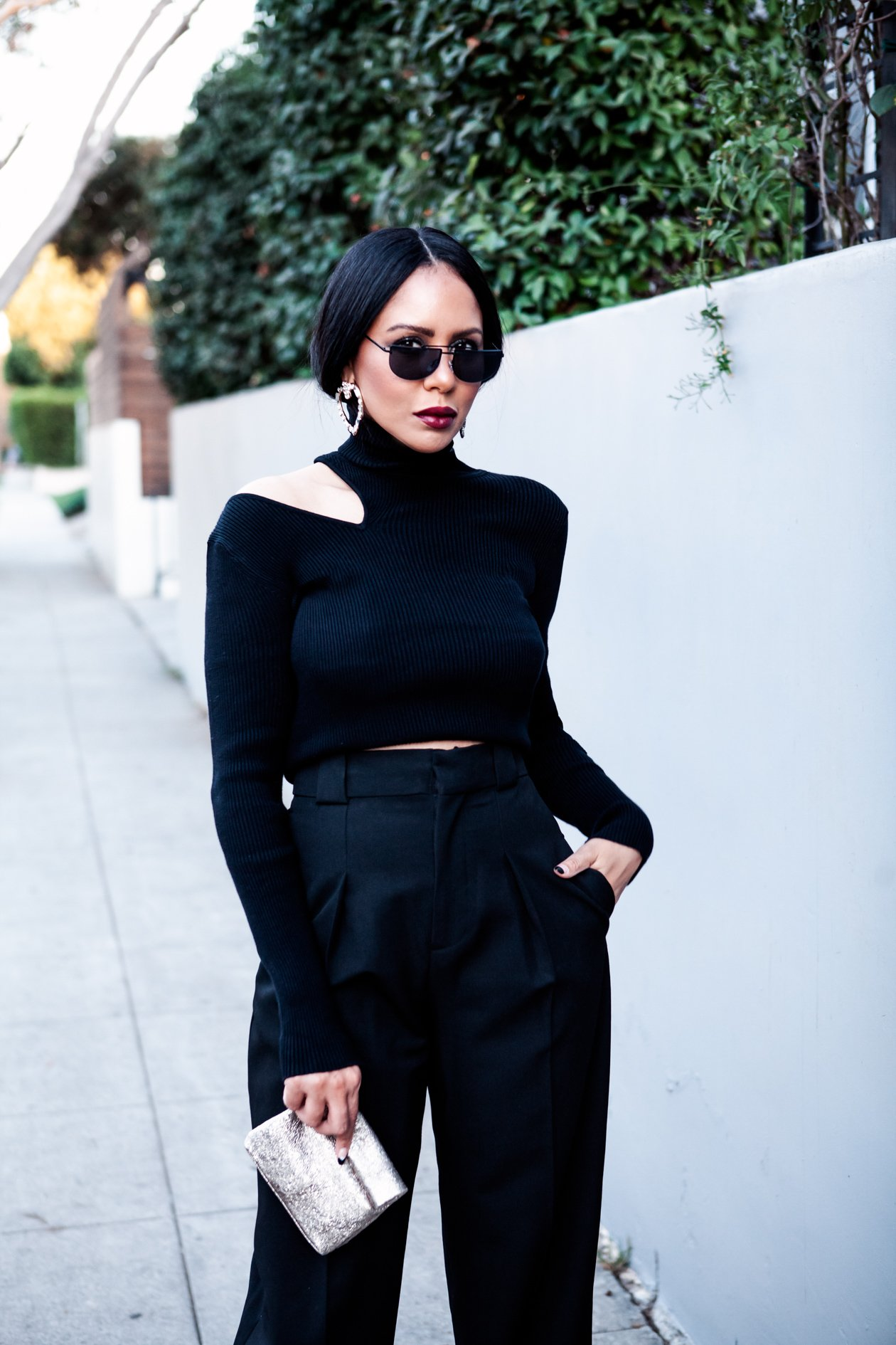 Black turtleneck and trousers with white boots