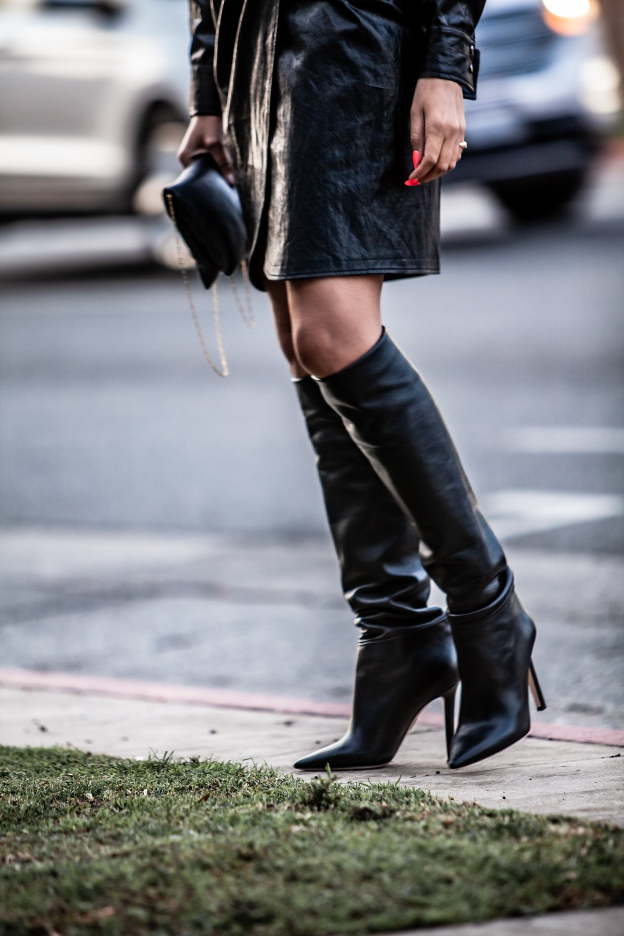 Fashion Blogger Taye Hansberry in Black Slouchy boots and faux leather dress.